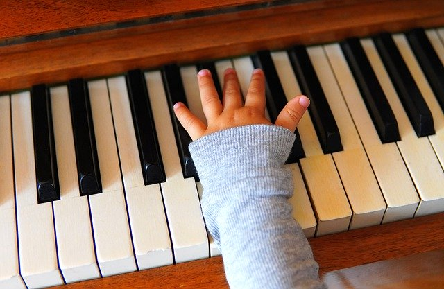 little hand on piano keyboard